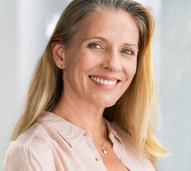 A beautiful middle-aged woman smiling